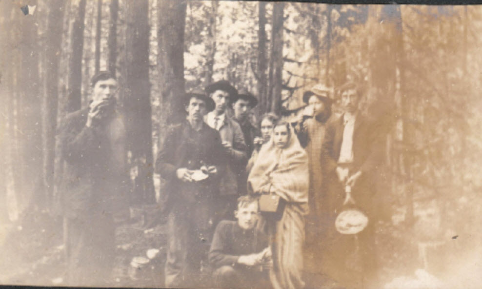 1909: Margaret-Johns and her friends having breakfast on a cold rainy morning at Lake Margaret. – Margaret-Johns Collection: 1909